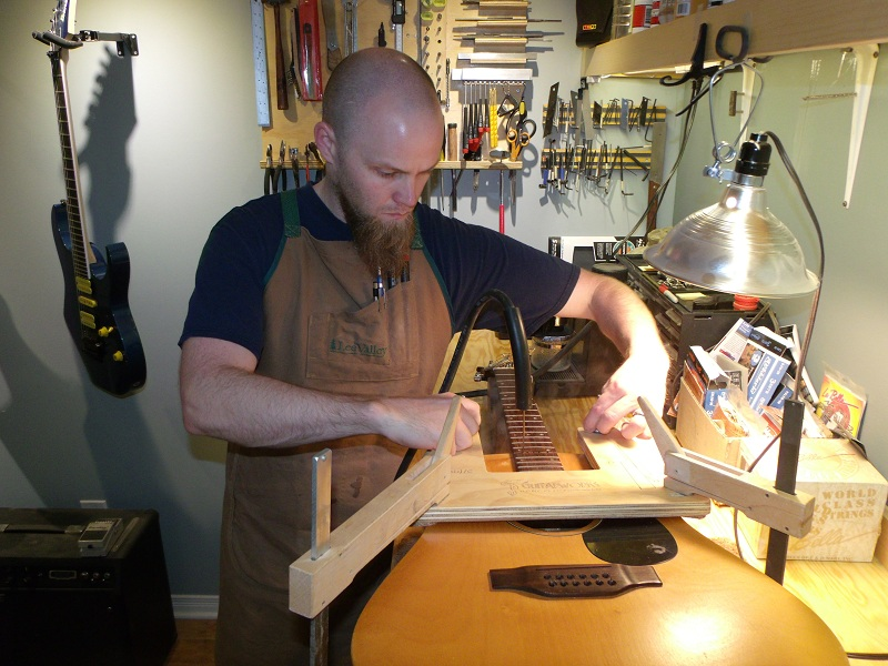 Luthier at STGuitarworks performing a Neck Re-Set